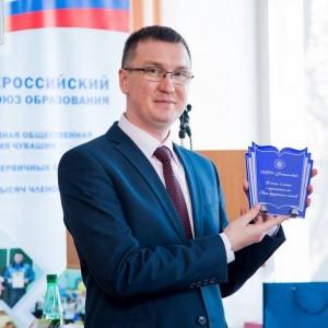 с наградой Лиги кредитных союзов России